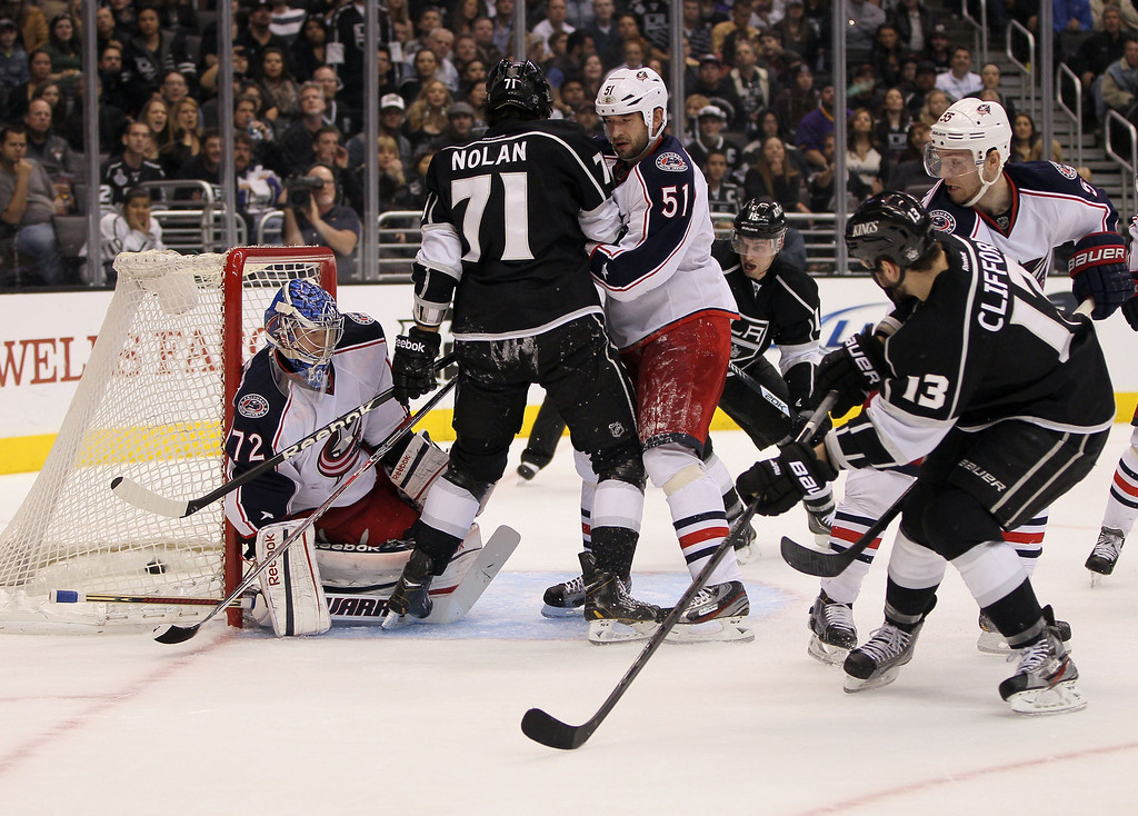 . LOS ANGELES, CA - APRIL 18:  Kyle Clifford #13 of the Los Angeles Kings scores against goaltender Sergei Bobrovsky #72 of the Columbus Blue Jackets in the second period during the NHL game at Staples Center on April 18, 2013 in Los Angeles, California. Clifford\'s goal was the eventual game-winning goal. The Kings defeated the Blue Jackets 2-1. (Photo by Victor Decolongon/Getty Images)