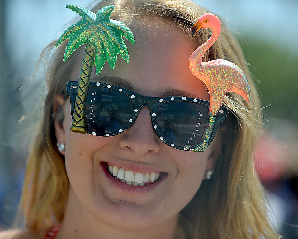 . 04-20-2013-(LANG Staff Photo by Sean Hiller)- Maddy Hefner,20, of Lake Forest sports some festive sunglassesToyota Grand Prix Saturday in Long Beach.
