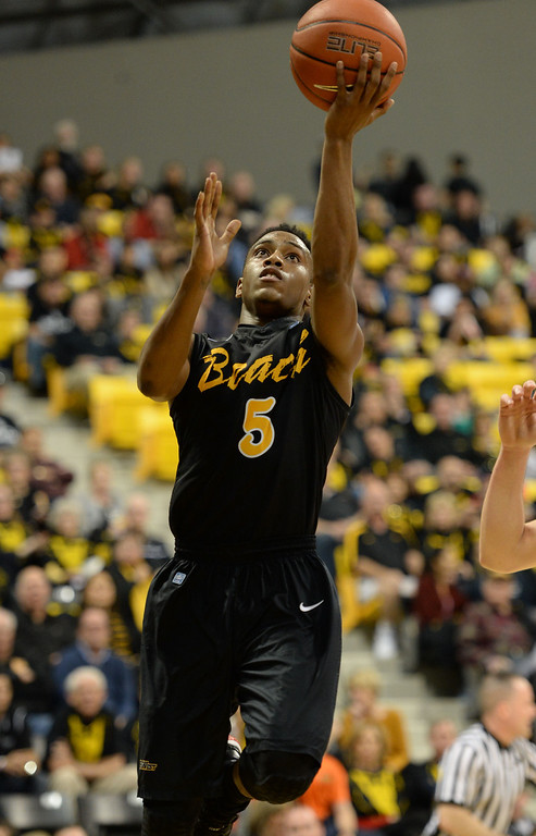 . Long Beach\'s Mike Caffey (5) takes the ball in against Fullerton\' in a Big West mens basketball game at the Pyramid Saturday, February 01, 2014, Long Beach CA.   Long Beach won 75-56. CSU Long Beach versus CSU Fullerton Photo by Steve McCrank/Daily Breeze