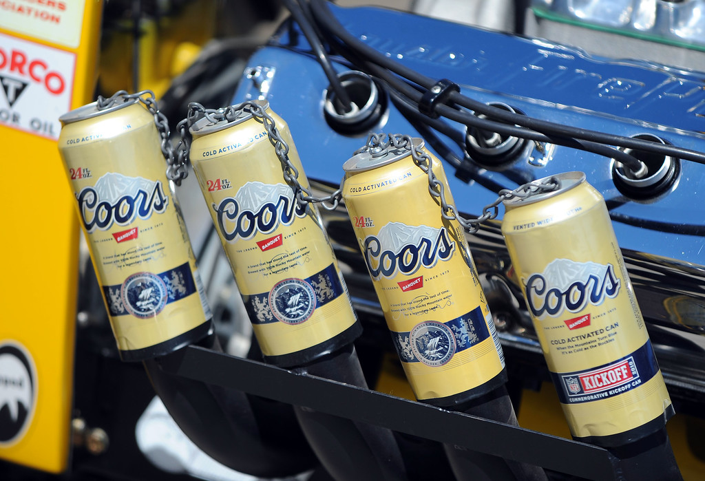 . The Gruzen Racing team is ready for this weekends Bellflower Car Show as they gather with two of their race cars at Leo and Sons Garage in Bellflower, CA on Wednesday, September 4, 2013. Coors cans cover the headers on the Newhouse Special dragster. (Photo by Scott Varley, PRESS-TELEGRAM)